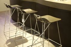 a series of bar stools designed by Poul Christiansen; fabrication by Dansk Interiør Design;