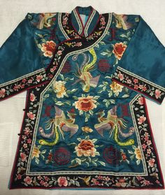 Vintage Blue Chinese hand embroidered Phoenix Peony Butterfly silk robe longevity symbols Antique Asian embroidery jacket kimono by VintageChineseSilk on Etsy https://www.etsy.com/listing/211182539/vintage-blue-chinese-hand-embroidered
