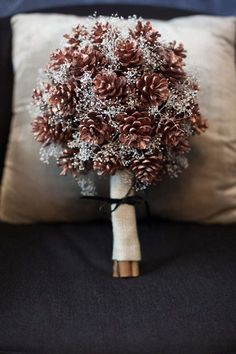 Use pine cones and glittery babies breath for a unique winter wedding bouquet.