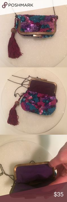 NWOT Tiny Sequin Purse Brand new! Never used! Very pretty jewel tone sequin purse. Fun tassel detail, purple lining. Chain measures 24 inches. 6 inches wide and 6 1/2 inches with top flap up. About 4 inches with flap closed. Has tiny pocket on the inside. Brand is Jasper & Jeera-purchased from Anthropologie. Anthropologie Bags Mini Bags