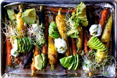 roasted carrots with avocado and yogurt - SMITTEN KITCHEN - NYC restaurants' favorite avocado and spiced carrot salad streamlined as a sheet pan roast with yogurt, salad and crunch (hooray). Vegetable Side Dishes, Vegetable Recipes, Vegetarian Recipes, Cooking Recipes, Healthy Recipes, Weekly Recipes, Vegetable Salad, Kitchen Recipes, Salad Recipes
