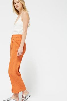 The Azalea Trousers, made from a crinkle blended fabric, are your go-to spring pant. Ever-so-slightly A-lined, with rounded back pockets and subtle front pleats.