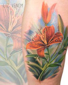 A stunning Tiger Lily tattoo from the talented Liz Venom at Bombshell tattoo, Edmonton.  Edmonton, YEG, Alberta, Canada, USA, Ink, Inked, sexy, idea, ideas, design, designs, drawings, sketch, memorial, art, artist, crazy, incredible, amazing, superb, best, talent, talented, beautiful, girls with tattoos, tattooed girls.
