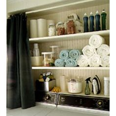 Shelves over top-loading washer and dryer
