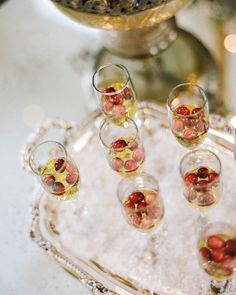 Kick off the party by clinking glasses of cranberry cocktails, using any bubbly as the drink's base. Leo cuts the berry's tartness by boiling them in pure apple or orange juice for 20 minutes with a pinch of sugar before adding them to each flute. Bridal Shower Drinks, Unique Bridal Shower, Bridal Shower Party, Bridal Shower Decorations, Bridal Shower Invitations, Winter Bridal Showers, Disney Bridal Showers, Baby Shower Winter, Wedding Showers