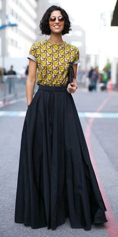We love the combination of the black maxi skirt and the printed top.
