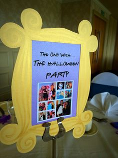 Friends themed wedding! Table name card with episode style title, Monica's peephole frame design and personal friends & family pics by Made Marvellous