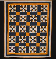 1880's North Carolina Lily What a graphically wonderful quilt! The color impact of the deeply dyed indigo with tiny white stars combined with vibrant vegetable dyed chrome orange is just stunning! The blocks are 11 inches square, with 5 3/8 inch indigo sashing and chrome joining blocks. Interestingly, the lilies in just one of the blocks have had a double pink fabric substituted for the chrome. The triple border is comprised of approximately 2 ¾ inch strips of chrome, indigo, and blue…