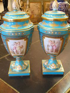 PAIR OF TURQUOISE SEVRES STYLE PORCELAIN AND JEWELLED LIDDED VASES