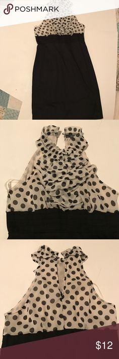 Polka-dot ruffle dress Ruffle polka dot on top half and solid black fitted bottom dress. Zipper in back. Never been worn like new twenty one Dresses Midi