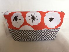 Makeup Bag Handmade Cosmetic Bag Peach Floral and Gray Southwestern Toiletry Bag Two Tone Make Up Bag Two Fabric Make Up Pouch by AmyReneeNicosia on Etsy https://www.etsy.com/listing/498285669/makeup-bag-handmade-cosmetic-bag-peach