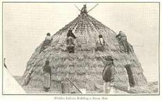 Wichita Indians building a straw hut