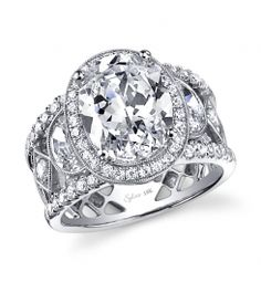 Style #SY555  4.5 carat oval cut diamond    This is bold Platinum diamond engagement ring features a 4.5 carat oval cut diamond. Graduating down the shoulders are 2 larger diamonds on either side. Round brilliant diamonds surround the center stone and flow down the sides of this ring for a total carat weight of 1.77 carats.