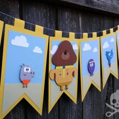 Decorate your Hey Duggee fans room with super cute banner! Its perfect for boys or girls with its mix of colors featuring the characters Duggee, Happy, Norrie, Betty, Tag and Roly. Each character has been pieced together with paper and is placed on foam dots for some extra dimension. Each pennant measures 5.75 inches wide and 9.5 inches high. This 100% handmade extra large pennant banner is made with colored cardstock. Its strung on 2 yards of light blue and white swirled twine and measures…
