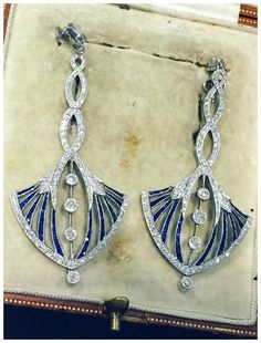 A magnificent pair of Art Deco sapphire and diamond earrings. At Rod Billing.