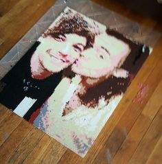 A portrait of Harry and Louis from one direction made in perler beads