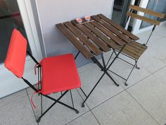 Price: 35 CHF. Two chairs with cushions and a matching table from IKEA (see link for details on the table and chairs).  Both chairs have identical cushions (only one pair pictured)