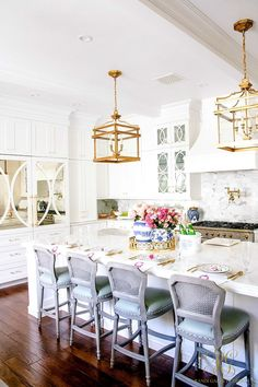 I love my kitchen! gray barstools, brass lantern pendants, white cabinets, white marble- Trend Alert Pink and Blue - Randi Garrett Design