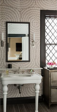 Great wallpaper, simple mirror, transitional sconces. Terrat Elms Interior Design.