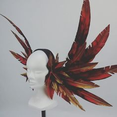 Fire Phoenix headdress. Each feather painted to resemble a flame that rises…