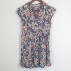 Blue floral cap sleeve dress Short blue dress with a floral pattern, collar, cap sleeves and slight ruffle on the hem. I like to use this as a tunic with leggings. Really comfy and can work for all seasons! Good used condition! Forever 21 Dresses