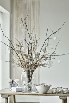 These glistening accessories are the perfect way to add some sophisticated sparkle into every corner of your home. Create your own winter wonderland by styling a glass vase with festive twigs and Christmas decorations, in your hallway or living room. Christmas Branches, Christmas Vases, Christmas Centerpieces, Xmas Decorations, Christmas Home, Christmas Holidays, Christmas Crafts, White Twig Christmas Tree, Christmas Hallway