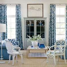True Blue Beach Retreat   den - shades of blue and various patterns harmonize without being matchy; 19th century grotto chair (on the left) shares the stage with a 1930s Frances Elkins Loop chair   CoastalLiving.com