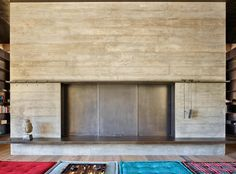 A large two-sided board-formed concrete fireplace with custom enclosure doors separates the main living and dining space from a more intimate media room. Two Sided Fireplace, Fireplace Doors, Concrete Fireplace, Whistler, Board Formed Concrete, Media Room Design, Mountain Homes, Mountain Biking, Global Design