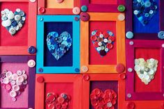 Buttons glued into a shape (here, hearts, but you could do anything), mounted on fabric! and put in a painted wooden frame.  Easy for the kids to do and beautiful.