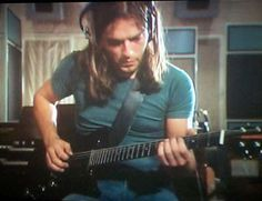 """Pink Floyd's David Gilmour playing guitar. His solos in """"Time"""" and """"Money"""" (Dark Side of the Moon) are my favorite guitar pieces."""