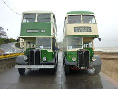 AEC Regent No 255 from Lisbon, Portugal and AEC Regent No 1 from Ipswich, Suffolk, England. The two friendly drivers are shaking hands!
