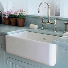 Love the large white ceramic sink with the light teal unit top