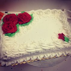 Buttercream sheet cake with roses and pearl sprinkles
