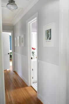 Board and batten for upstairs hallway - Young House Love hallway: board & batten is Benjamin Moore Advance paint in Decorator's White // walls are: Moonshine by Benjamin Moore Young House Love, Upstairs Hallway, Gray Hallway, Hallway Colors, Hallway Walls, Long Hallway, Ikea Frames, Foyer Decorating, Narrow Hallway Decorating