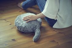 Qoobo is a robotic pillow that vibrates and wags its fluffy tail when you pet it. It is supposed to be an alternative for people who can't have living pets.