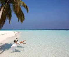 swing over the ocean - Tropical summer beach vacation escape