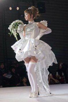 The dress was on display at Tokyo Bridal Festa 2011. It's a wedding dress that the manga/anime creator team CLAMP designed in the motif of Cardcaptor Sakura.