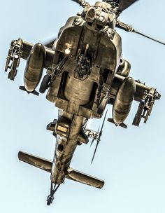 The underside of a Boeing AH-64 Apache helicopter
