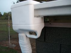To save money when putting in a rain catchment system, use a kitty litter jug at the end of the gutter to feed into the barrel.