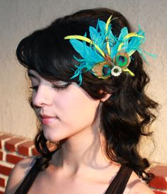 Turquoise Blue Goose and Ostrich Feathers and Natural peacock Feathers with Lime green accents Boutique Hair Clip Fascinator Photp Prop. $27.99, via Etsy.