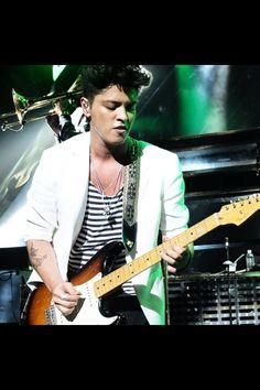 He looks just like Elvis in this! Bruno Mars