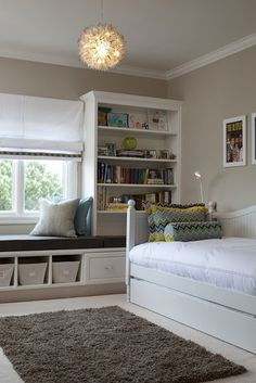 built in window seat.   Love this idea for a guest room. Love the whole room