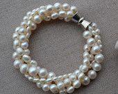 pearl bracelet,white pearl bracelet,freshwater pearl bracelet,4 rows pearl bracelet,6-14mm pearl bracelet,free shipping. $12.00, via Etsy.