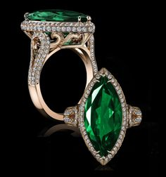 A regal marquise cut emerald of 4cts is elegantly mounted in 18K rose gold to accentuate the rich green color, with precision set micro pave of sculpted tendrils and sumptuous curves accentuating the color of this exceptional emerald. Detailed and intricate, this special marquis emerald is a one-of-a-kind work of art.
