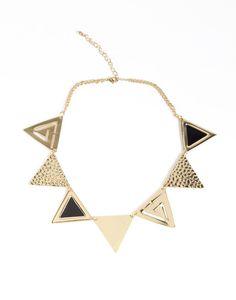 triple design necklace.