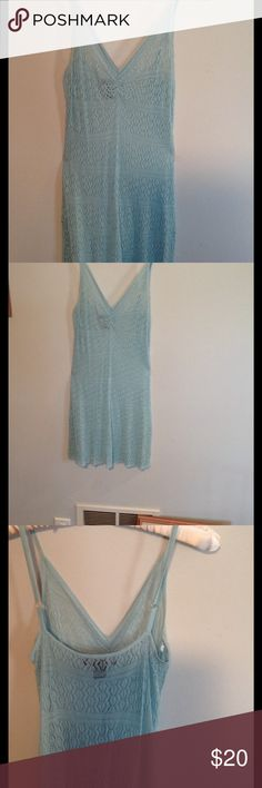 Lacy coverup Thin adjustable straps on a V neck top that you wear a  body stocking underneath, or a bathing suit cover up. 100% Rayon. Beautiful turquoise color Arden B Swim Coverups