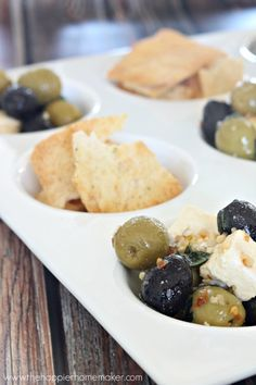 Marinated Olives and Feta make the perfect appetizer. I like to serve the olives with parmesan pita chips-the saltiness pairs so well with the olives and feta!