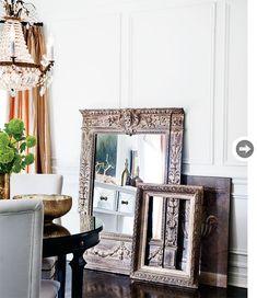 Vintage frames on the floor create a vignette of artwork.