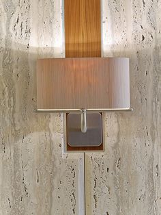 Midtown Architecture Inspires SmithMaran for Insight Venture Partners | A sconce in the elevator lobby is stainless steel. #design #interiordesign #interiordesignmagazine #projects #offices #newyorkcity