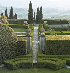 Villa La Foce, Vakl d'Orcia, Tuscany. As you reach the balustrade at the end of the pathway, there suddenly appears beneath you a lower garden projecting like the deck of a shift over the distant valley.